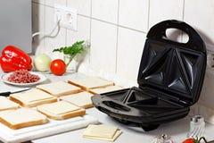 Κατασκευαστής σάντουιτς. στοκ εικόνες
