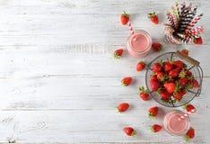 Καταφερτζήδες με τις φράουλες στοκ φωτογραφία