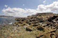 Κατοικία και residentials κάτω από την παραλία κατασκευής στην ακτή του antonio SAN στο ισπανικό των Βαλεαρίδων $νήσων νησί του i Στοκ εικόνες με δικαίωμα ελεύθερης χρήσης