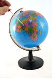 Κατσαβίδι χεριών που καθορίζει τον κόσμο Στοκ Εικόνες