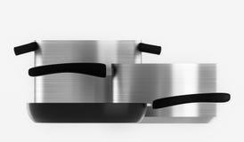Κατσαρόλλες μετάλλων και ένα τηγανίζοντας τηγάνι Στοκ εικόνα με δικαίωμα ελεύθερης χρήσης