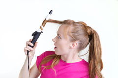 κατσαρώνοντας κορίτσι στοκ εικόνα
