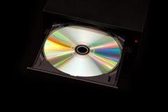 Καυστήρας DVD/του CD στο μαύρο υπόβαθρο Στοκ Εικόνα