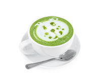 Καυτή τέχνη matcha latte με τα χαριτωμένα κινούμενα σχέδια προσώπου σκυλιών στον πίνακα ο γυαλιού Στοκ φωτογραφία με δικαίωμα ελεύθερης χρήσης