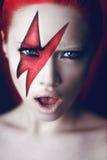 Καυτό βάναυσο κορίτσι στο κόκκινο Στοκ Φωτογραφία