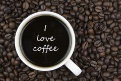 καφές ι αγάπη κείμενο στο φλυτζάνι καφέ Στοκ Φωτογραφίες