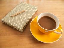 Καφές και σημειωματάριο Στοκ Εικόνες