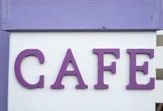 Καφές λέξης στην πορφύρα χρώματος στο λευκό Στοκ Εικόνες