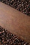 Καφές στην ξύλινη ανασκόπηση Στοκ φωτογραφία με δικαίωμα ελεύθερης χρήσης