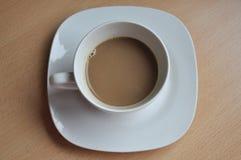Καφές: φλυτζάνι καφέ σε έναν ξύλινο πίνακα Στοκ Εικόνες