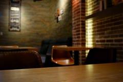 Καφές bokeh και πίνακας Στοκ Φωτογραφία