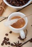 Καφές Espresso με τη ζάχαρη και το καρύκευμα Στοκ Φωτογραφία