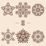 Καφετί πακέτο σχεδίων λουλουδιών Στοκ Εικόνες