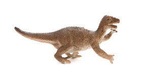 Καφετί πλαστικό παιχνίδι δεινοσαύρων πλάγιας όψης στο άσπρο υπόβαθρο Στοκ Εικόνα