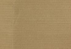 Καφετί υπόβαθρο επιφάνειας ζαρωμένου χαρτονιού Στοκ Εικόνες
