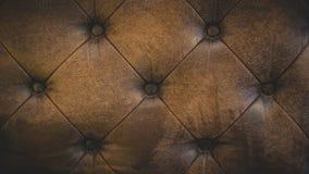 Καφετί υπόβαθρο σύστασης μαξιλαριών δέρματος στοκ εικόνα