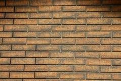 Καφετιά γκρίζα σύσταση από τα τούβλα του τεμαχίου τοίχων σπιτιών Στοκ Εικόνα