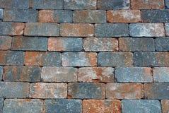 Καφετιά γκρίζα σύσταση από τα τούβλα του τοίχου σπιτιών Στοκ εικόνες με δικαίωμα ελεύθερης χρήσης