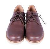Καφετιά παπούτσια ατόμων ` s δέρματος που απομονώνονται στο άσπρο υπόβαθρο Στοκ Εικόνα