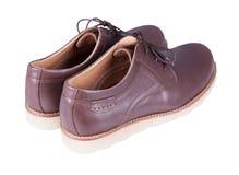 Καφετιά παπούτσια ατόμων ` s δέρματος που απομονώνονται στο άσπρο υπόβαθρο Στοκ φωτογραφία με δικαίωμα ελεύθερης χρήσης