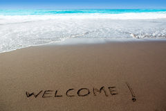 Καφετιά παραλία άμμου με τη γραπτή υποδοχή λέξης Στοκ Εικόνες