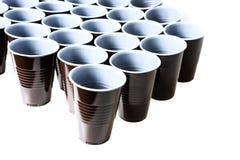Καφετιά πλαστικά φλυτζάνια Στοκ Εικόνες