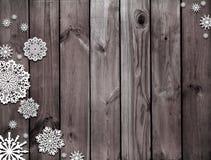 καφετιά σύσταση ξύλινη Μυστήρια νύχτα Χριστουγέννων Χειμώνας Σκοτεινό καφετί υπόβαθρο Χριστουγέννων Χιόνι και snowflakes Στοκ Εικόνες