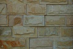 Καφετιά σύσταση πετρών των τούβλων στον τοίχο ενός κτηρίου Στοκ Εικόνα