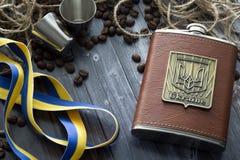 Καφετιά φιάλη του κονιάκ και του καφέ από την Ουκρανία Στοκ εικόνες με δικαίωμα ελεύθερης χρήσης