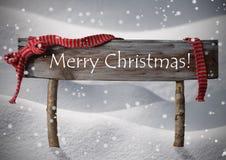 Καφετιά Χαρούμενα Χριστούγεννα σημαδιών, χιόνι, Snowfalkes, κόκκινη κορδέλλα Στοκ Εικόνες