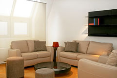 καφετιοί καναπέδες δέρμα& Στοκ Εικόνα