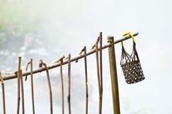 Καλάθι και ραβδί με το καυτό ελατήριο Στοκ Φωτογραφίες