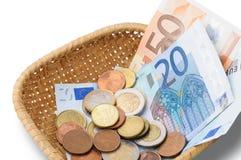 Καλάθι με τα χρήματα ευρώ Στοκ Φωτογραφίες