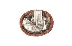 Καλάθι τα δολάρια που απομονώνονται με στο λευκό Στοκ Φωτογραφία
