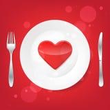 Καλά τρόφιμα Δίκρανο και μαχαίρι και καρδιά στο πιάτο Στοκ Εικόνες