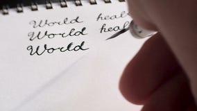 Καλλιγραφία και ημέρας παγκόσμιας υγείας Τρίτη γραμμή Κινηματογράφηση σε πρώτο πλάνο απόθεμα βίντεο