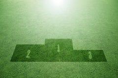 Καλλιτεχνικό υπόβαθρο εξεδρών νικητών χλόης Στοκ φωτογραφία με δικαίωμα ελεύθερης χρήσης