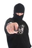 Καλυμμένοι στόχοι ατόμων από το πυροβόλο όπλο σε σας Εστίαση στο πυροβόλο όπλο Στοκ Φωτογραφίες