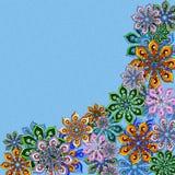 Καλυμμένο λουλούδι πλαίσιο στο μπλε Στοκ φωτογραφία με δικαίωμα ελεύθερης χρήσης