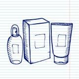 Καλλυντικό μπουκαλιών στο copybook Στοκ Φωτογραφίες