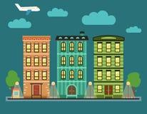Καλό ζωηρόχρωμο στο κέντρο της πόλης τοπίο πόλεων με διάφορα townhouses, Στοκ Εικόνες