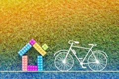Καλό σπίτι με το ποδήλατο που επισύρει την προσοχή στο υπόβαθρο χλόης jpg Στοκ Εικόνες