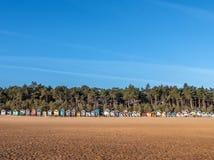 Καλύβες παραλιών στην ανατολή Στοκ Εικόνες