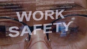 Κείμενο ασφάλειας εργασίας στο υπόβαθρο του θηλυκού υπεύθυνου για την ανάπτυξη απόθεμα βίντεο