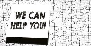 Κείμενο γραψίματος λέξης μπορούμε να σας βοηθήσουμε Επιχειρησιακή έννοια για την προσφορά της καλής βοήθειας στο κομμάτι πελατών  στοκ εικόνες με δικαίωμα ελεύθερης χρήσης