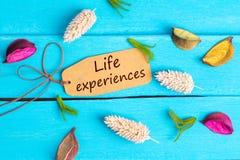 Κείμενο εμπειρίας ζωής στην ετικέττα εγγράφου στοκ φωτογραφία