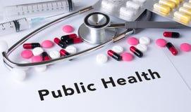 Κείμενο δημόσιας υγείας στο υπόβαθρο της σύνθεσης φαρμάκων Στοκ Φωτογραφία
