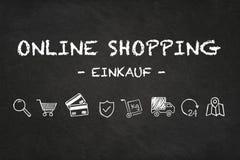 """Κείμενο και εικονίδια on-line αγορών """"Einkauf """"στο υπόβαθρο πινάκων κιμωλίας Μετάφραση: """"αγορά """" ελεύθερη απεικόνιση δικαιώματος"""