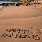 Κείμενο καλές διακοπές στην άμμο μιας παραλίας Στοκ Εικόνα
