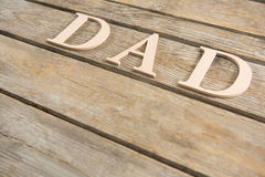 Κείμενο μπαμπάδων στον ξύλινο πίνακα Στοκ Φωτογραφίες